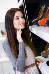 Portrait of woman choosing a pair of footwear