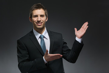 Half-length portrait of businessman pointing at something