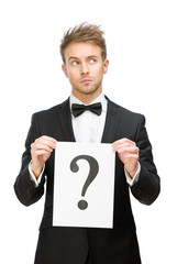Half-length portrait of businessman handing question mark