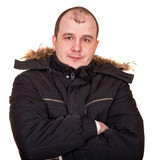 portrait of a man in warm jacket on a white background