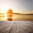 ancient pavilion in hangzhou with sunset glow