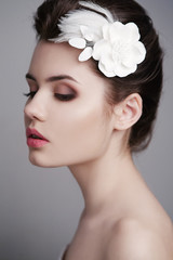 Sexy woman with white flower in her hair