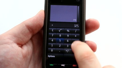 Male hand calculating with the index finger on cell phone
