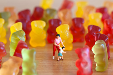 Gummy bear invasion. Harmful/ junk food concept