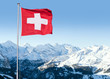 Leinwanddruck Bild - Swiss Flag Flying Over Alpine Scenery