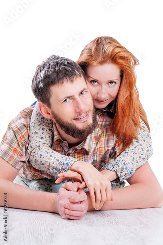 Young attractive couple embracing isolated on white