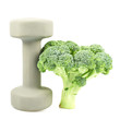Green broccoli next to a dumbbell