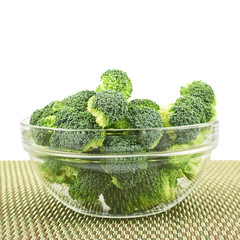 Glass bowl full of green broccoli