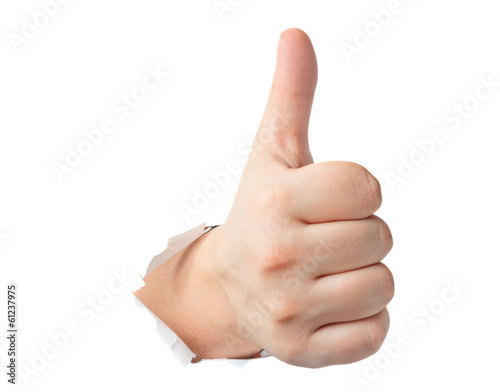 Thumbs up gesture showing through the paper