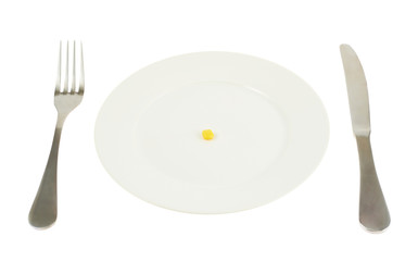 Plate with a single corn kernel isolated