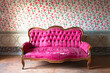 Old damaged red couch in an antique house. Flowers wallpaper - 61238761