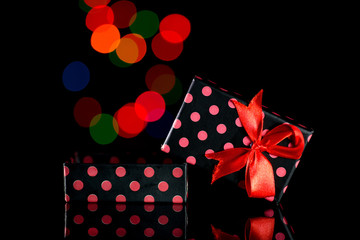 Gift Box in black background and colorful bokeh
