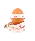 egg and  measurement tape isolated on white background