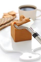 Scandinavian brown cheese, crispy bread and coffee
