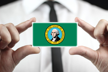 Businessman holding a business card with Washington State Flag