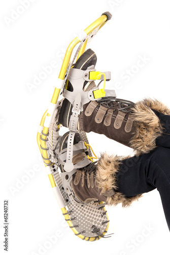 snowshoes and boots isolated on white background
