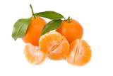 Two mandarines or tangerines with leaves and peeled one