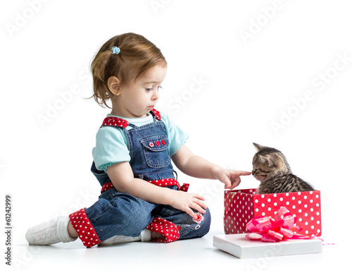 happy child girl playing with kitten