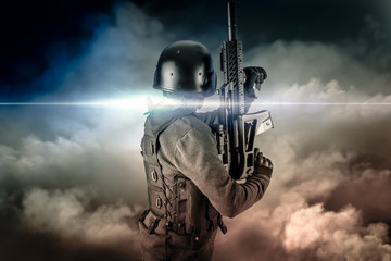 Soldier in uniform with rifle, assault sniper on apocalyptic clo