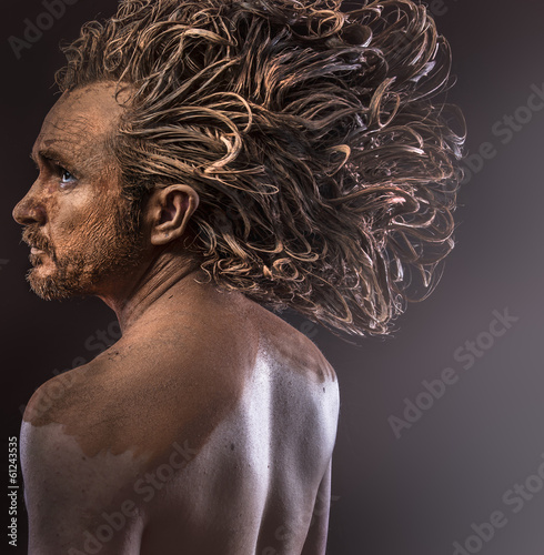 Huge hair, wild man, tribal concept, traditions, body covered wi