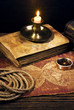 ancient books with candle and Compass