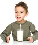 Cute boy with a glass of milk