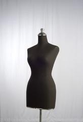 dark mannequin display with light background