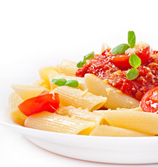 Penne pasta with bolognese sauce, parmesan cheese and basil