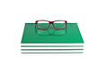 Eyeglasses on a stack of books on white background
