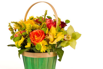 bright flowers in a basket on a white background