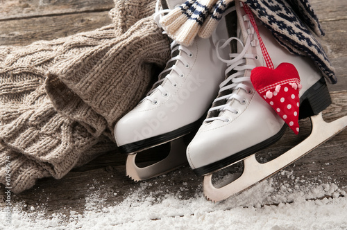 White ice skates on old wooden boards