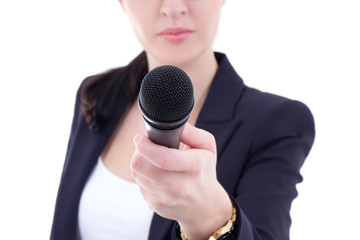 microphone in female  reporter's hand over white