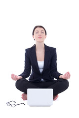young businesswoman sitting in yoga pose with laptop isolated on