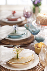 Selective focus view of Spring or Easter dining place settings