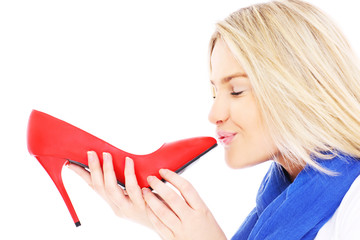Woman kissing red heels