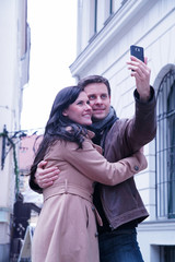 Couple taking a picture with their mobile phone
