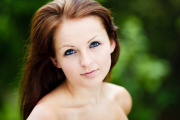 Beautiful Blue Eyed Woman. Beauty Portrait. Green Background.
