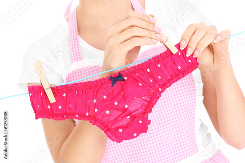 Woman hanging up laundry