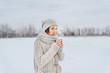 Woman with mug outdoors