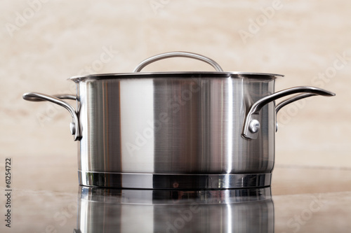 One new metal pot on kitchen top