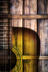 acoustic guitar on wooden wall background