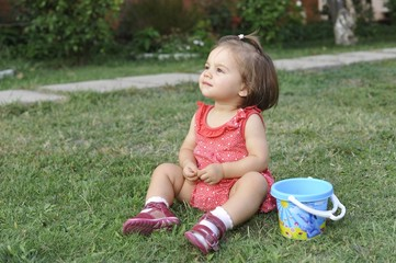 Baby Girl Playing On Grass