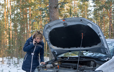 Winter car breakdown, Woman call for help, road assistance