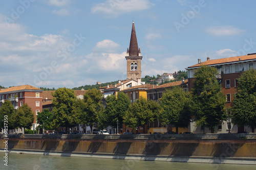 Buildings and church on quay in Verona