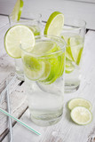 glasses of mineral water and a slice of lime