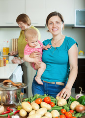 Happy women of three generations in  kitchen