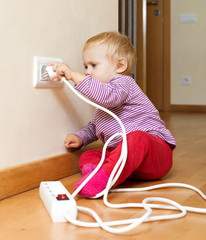 toddler playing with electricity at home