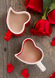 Cups with cocoa in the form of hearts with roses.