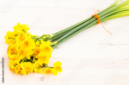 Bouqut of yellow lent lilyl (daffodil) on a wooden table