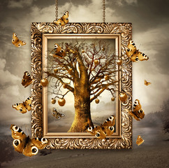 Magic tree with golden apples and butterflies in frame. Concept